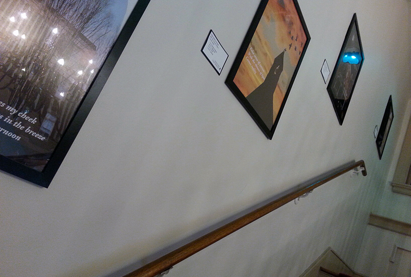 Old North staircase with haiku posters displayed.